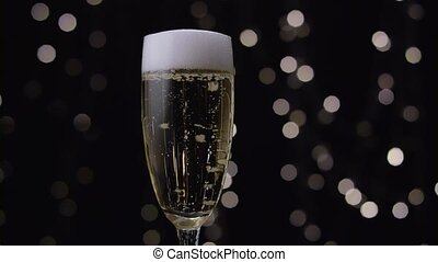 Champagne pours out white foam through the edges of the...