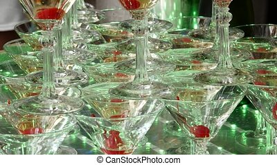 Champagne pyramid for parties with cherries. Accessories for alcohol. Festive table setting for the big Banquet. 4K