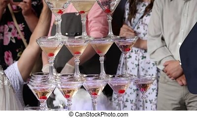 Champagne pyramid for parties with cherries. Accessories for...