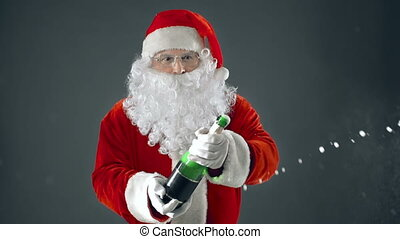 Champagne Showers - Santa Claus popping bottle of sparkling...