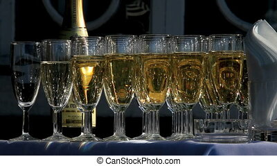 champagne - Table covered with glasses of sparkling wine.