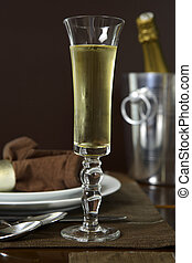 Champagne toast - Chilled Champagne in a flute at the table