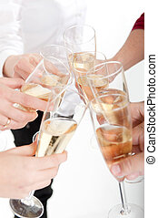 Champagne toast - Seven hands raising champagne flutes on a...