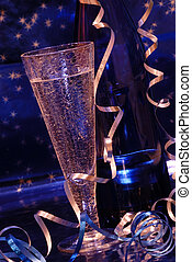 Champagne Toast - Crystal champagne flute and blue bottle of...