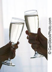 champagne toast - hands toasting with champagne
