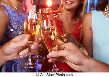 Champagne toast - Close-up of hands clinking champagne...