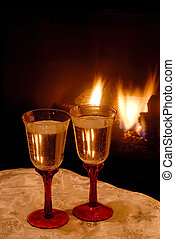 Champagne Toast - Two glasses of bubbly champagne wine in...