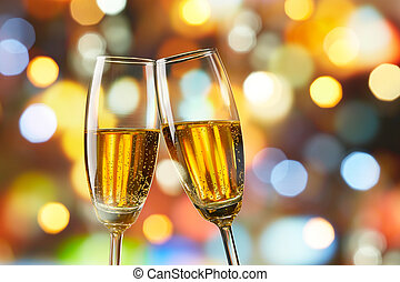 champagne toast - two glasses of champagne toasting against...