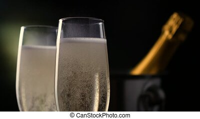 Champagne. Two Flutes with bottle of champagne in an ice...