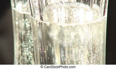 Champagne - Sparkling champagne in two glasses.