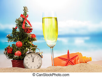 Champagne with Christmas decoration on the beach