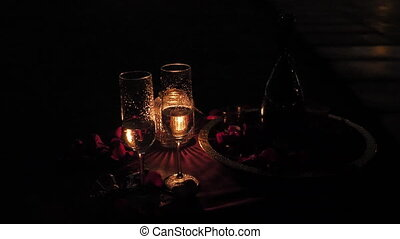 Champagne with glasses on a romantic evening