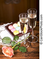 champagne with macaroons - Two glasses of sparkling wine or...