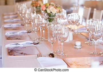 Champaigne and wine glasses on table at wedding reception -...