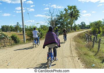 CHAMPASAK, LAOS - MAY 9: The Laos Local Field on MAY 9, 2016, in Champasak, Laos. Young tourists cycling trip in Laos .