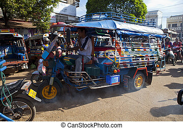 Champasak Laos - Nov23- three wheel vehicle in Doawreung...