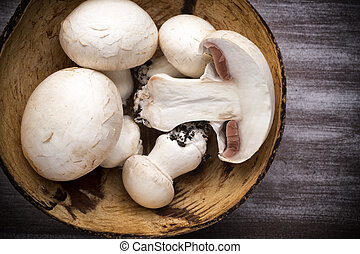 Champignon. - Fresh champignon on a wooden table. New crop.