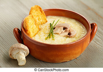 champignon mushroom soup with chives and croutons