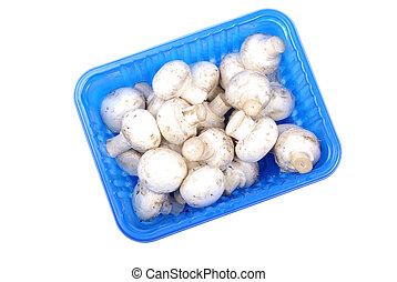 Champignon mushrooms in blue pack isolated on white background.
