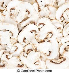 Champignon mushrooms sliced raw food pattern background texture