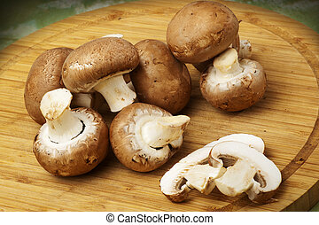 Champignon mushrooms with brown variety on wooden table and ...