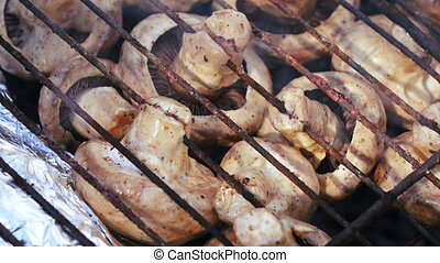 Champignon skewer on nature - In grill on fire champignons