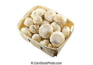 Champignons - Champignon mushrooms in a wooden basket on...
