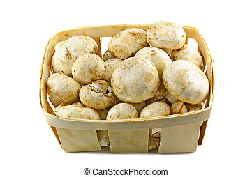 Champignons - Champignon mushrooms in a wooden basket on...