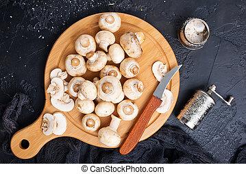 Champignons - raw mushrooms on wooden board, Champignon...