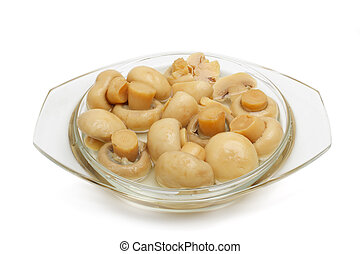 Champignons - The tinned champignons in a plate are isolated...