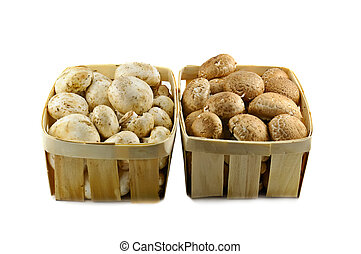 Champignons - Two wooden baskets with different kinds of...