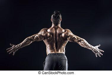 champion - Beautiful muscular man bodybuilder posing back...
