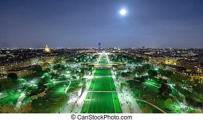Champs de Mars from the Eiffel tower at night with rising...