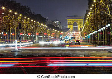 Champs-Elysees with heavy traffic at night, Paris, France