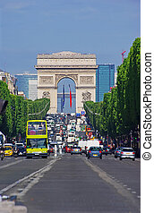 Champs Elysees, Paris - Vehicles travel along Champs Elysees...