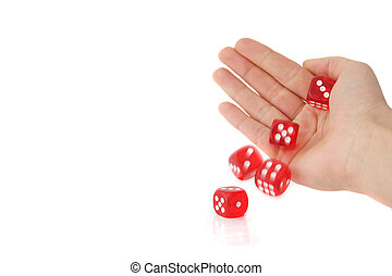 A human hand rolling several red dices. All isolated on white background.