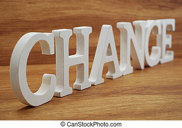 Chance word alphabet letters on wooden background