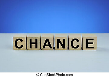 Chance word cube on wood, Business concept
