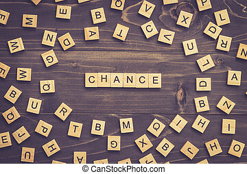 Chance word wood block on table for business concept.