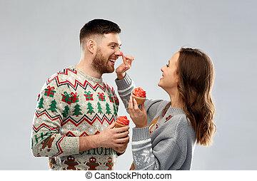 chandails, couple, laid, petits gâteaux, noël