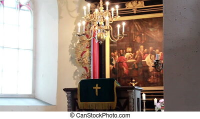 Chandelier at church and a painting at the back