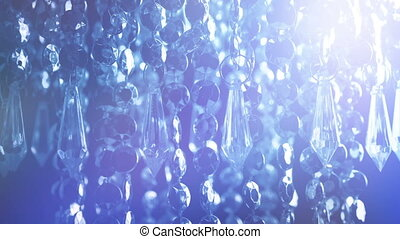 Chandelier In Flashing Lights At Party - Closeup shot of...