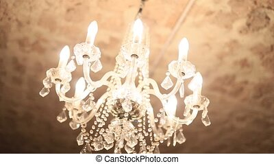 Chandelier in the apartment. A beautiful chandelier on the...