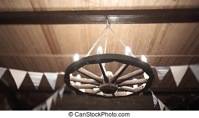 Chandelier in the form of a wheel.
