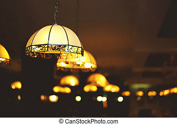 Chandelier light in interior closeup with blurred background