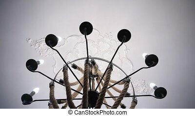 Chandelier light on ceiling.