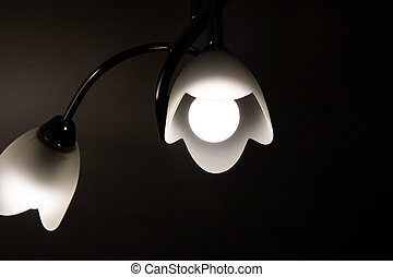 Chandelier with a lamp in the dark