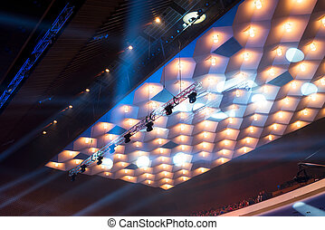 chandeliers and stage lights under the ceiling