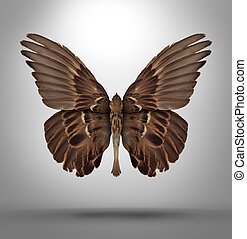 Change and adaptation concept with a an open wing bird shaped as a butterfly as a surreal symbol of new breed creative thinking and freedom in changing to adapt to new challenges in business and life.