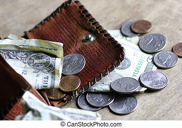 change and crumpled banknote